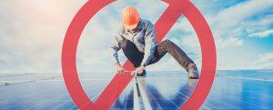 PVDynamics man standing on solar panels